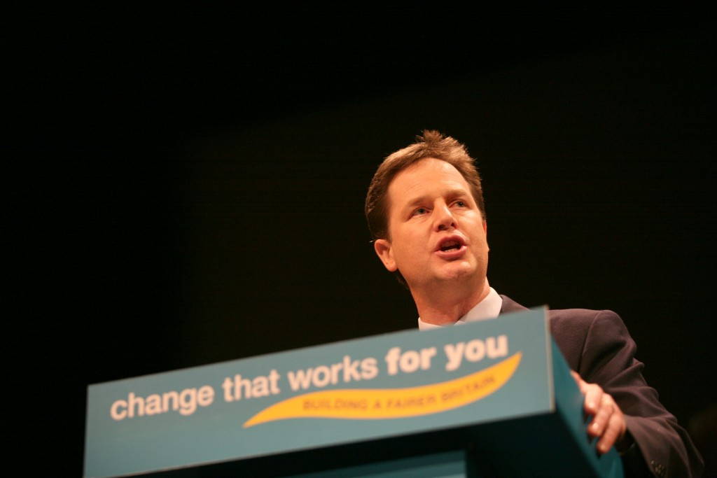 Nick Clegg, leader of Liberal Democrats, speaking to an audience with slogan 'Change that works for you'