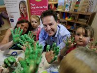 Liberal Democrat leader Nick Clegg along with parliamentary candidate Vikke Sladi (left) make play dough with Abi Round (second left) and Grace Lewis (right) as he visits Tops Day Nursery, Corfe Mullen in Dorset while on the General Election campaign trail.